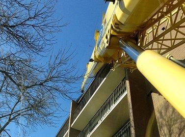 Crane extended above balconies